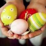 Child Hands Holding Colorful Easter Eggs